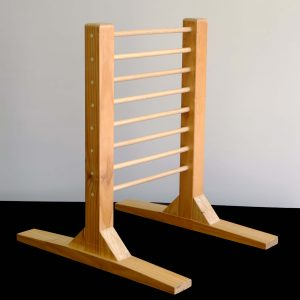 A sturdy ladder for children to learn how to move from a seated to standing position.